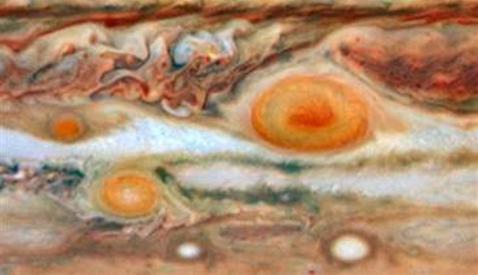 Image: Three red spots on Jupiter